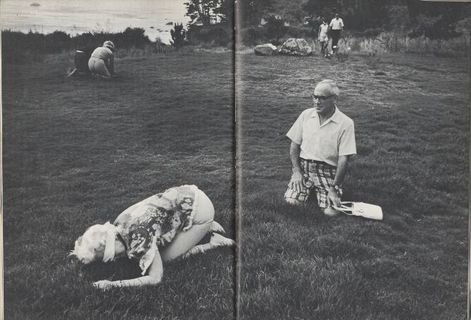 kneeling in a field
