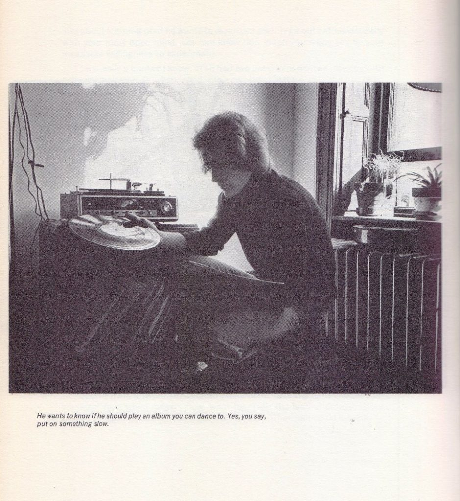 man playing records