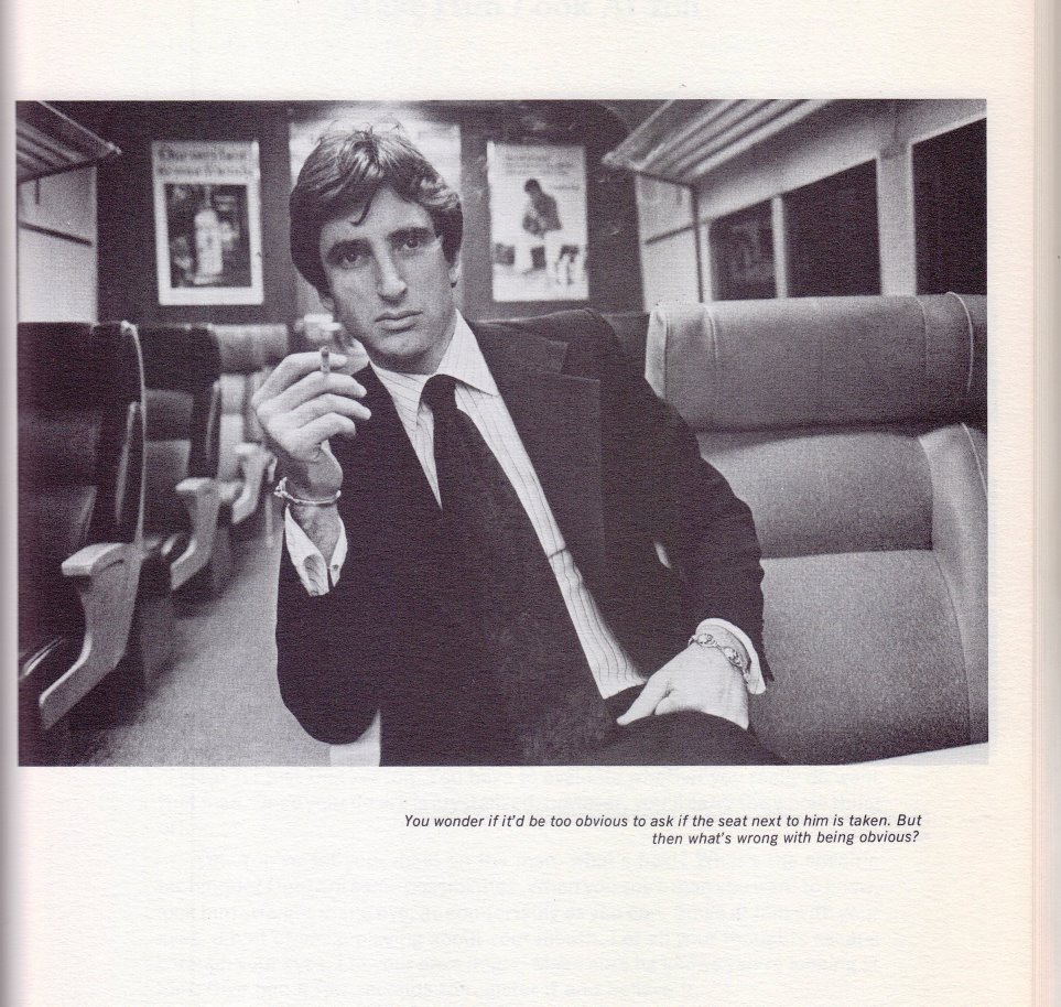 man smoking on a train