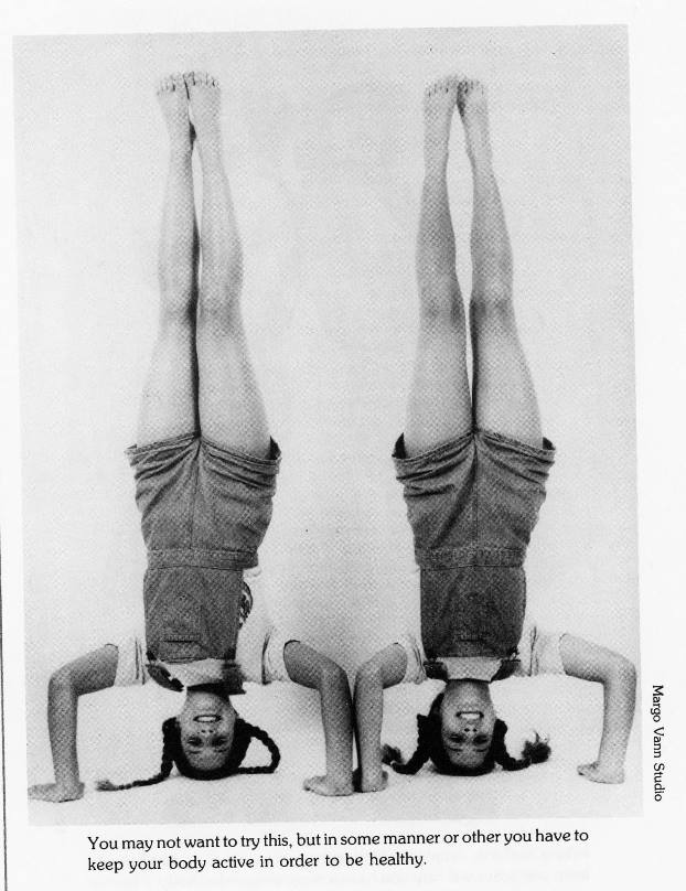 twins doing a headstand