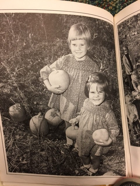 Young girls in a pumpkin patch