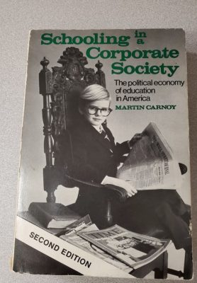 Schooling in corporate society cover